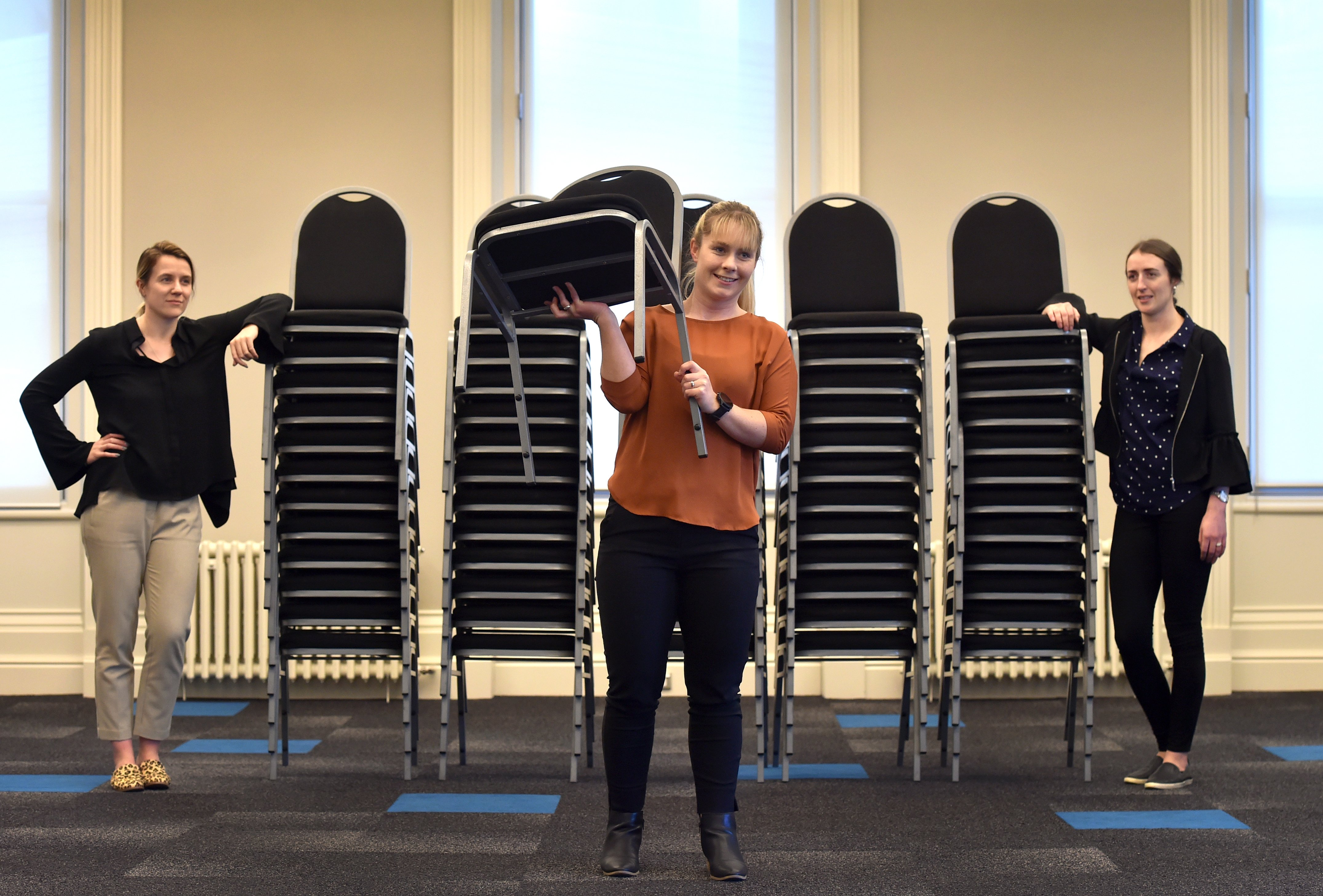 Chairs remain stacked up at the Dunedin Centre but members of the Dunedin Venues team (from left)...