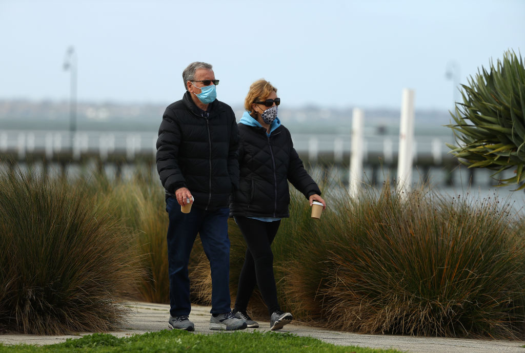 People walk along Port Melbourne Beach in Melbourne, which remains under stage 4 lockdown...