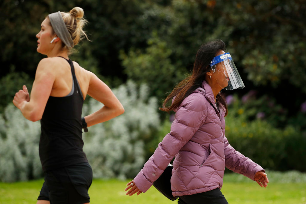 People out in a Melbourne park as Covid restrictions ease in Victoria. Photo: Getty