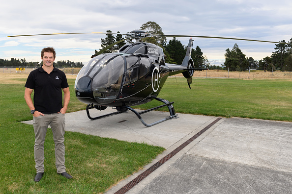 Richie McCaw poses in front of a helicopter. Photo: Getty Images