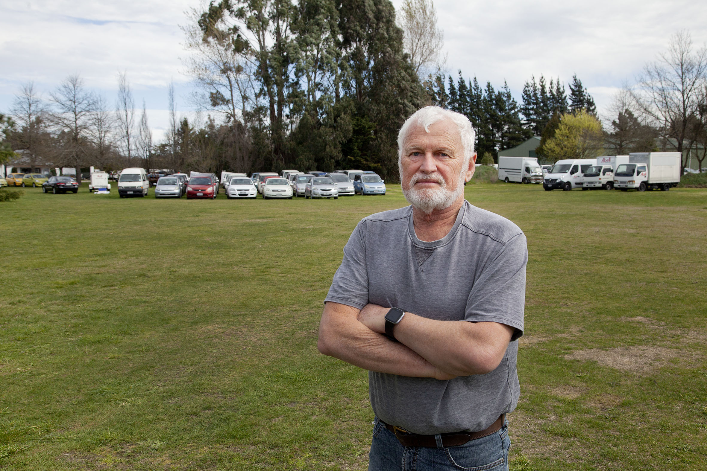 Allan Scott with some of the 80 vehicles he has on his property. Photo: Geoff Sloan
