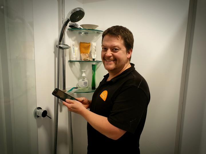 Sustainability Trust home assessor Karl Wheddon says phones in the shower are hampering efforts...