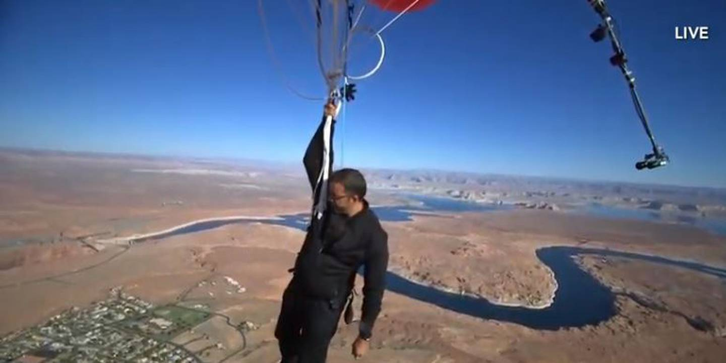 David Blaine reached 24,700 feet before letting go of the balloons and parachuting back down to...