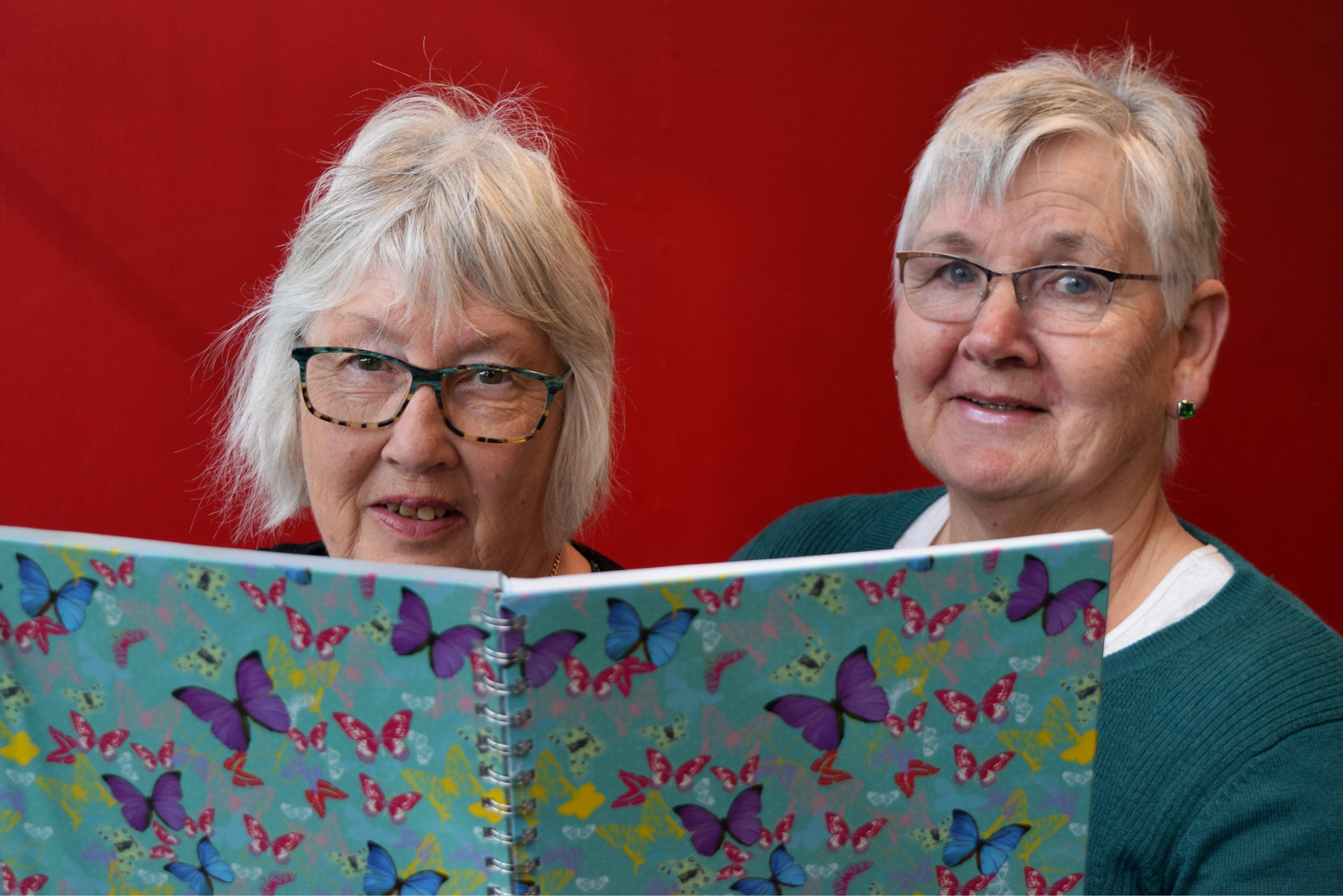 Mosgiel Market co-ordinators Janelle Roguski (left) and Maryanne Ashford have a list of vendors...