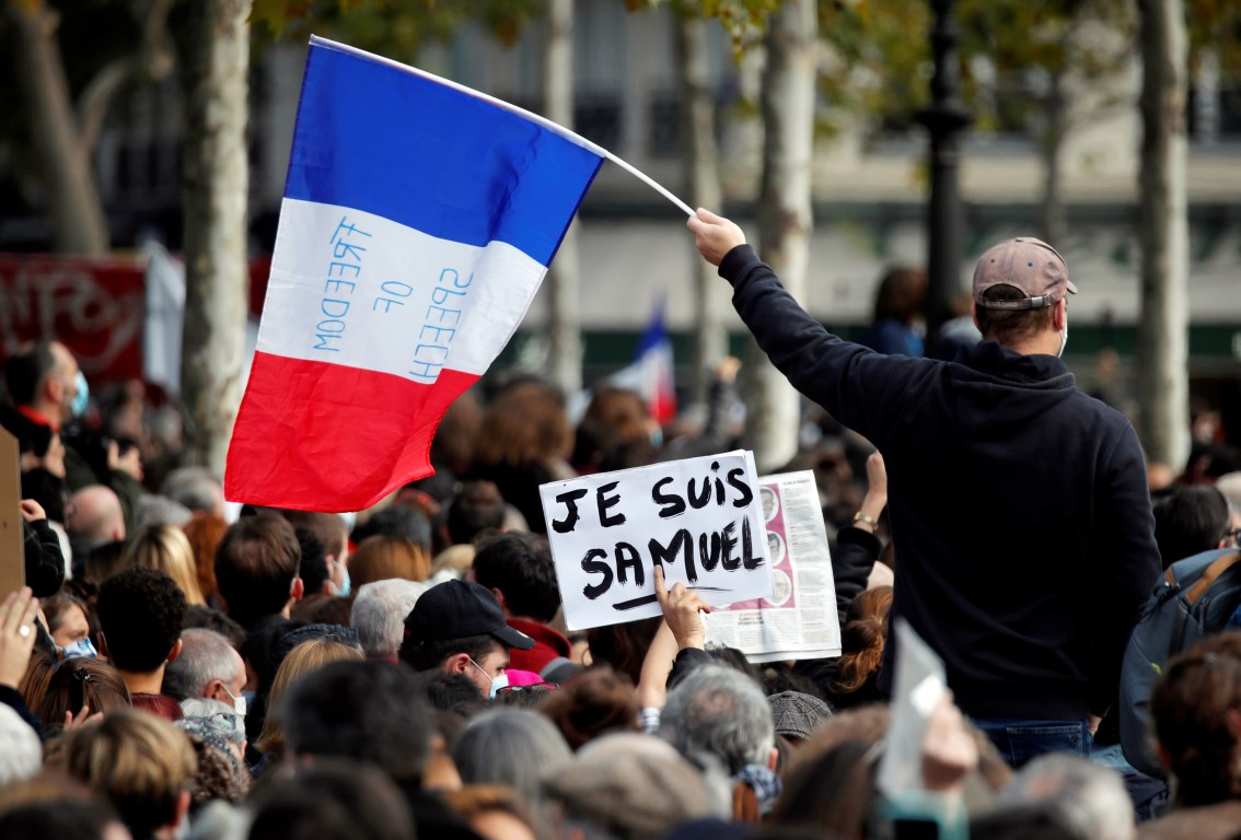 People gather at the Place de la Republique in Paris to pay tribute to Samuel Paty. Photo: Reuters