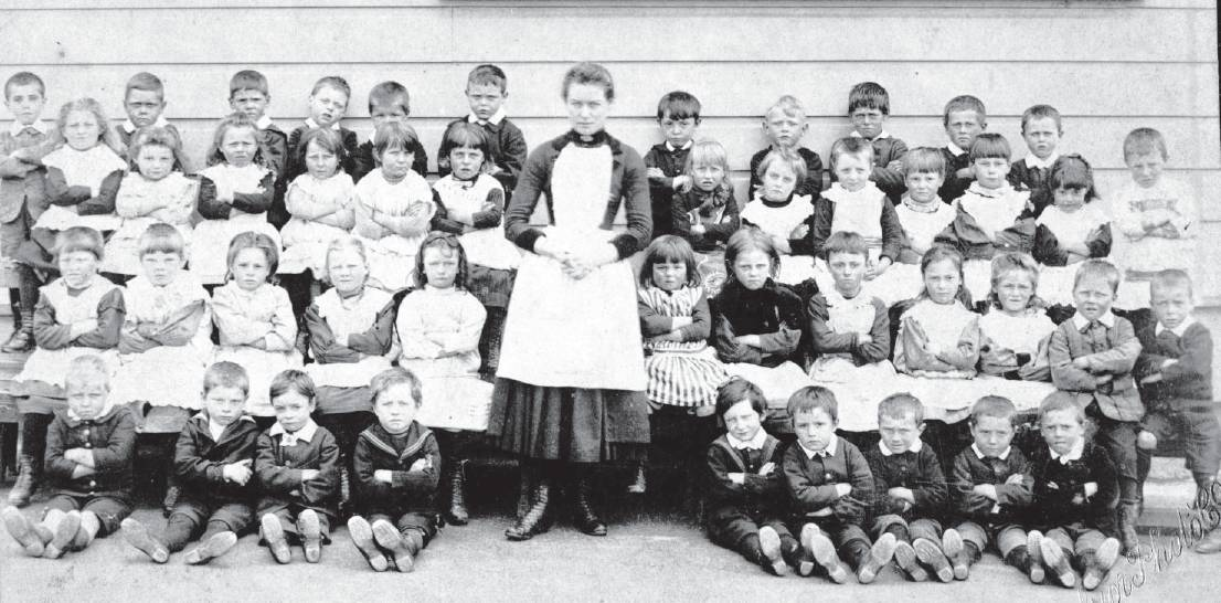Pupils pictured outside the Arthur Street School infants' building about 1889. PHOTO: HOCKEN...