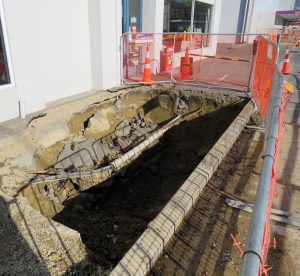 The hole in the ground where the tank is buried. Photo: Ashburton Courier