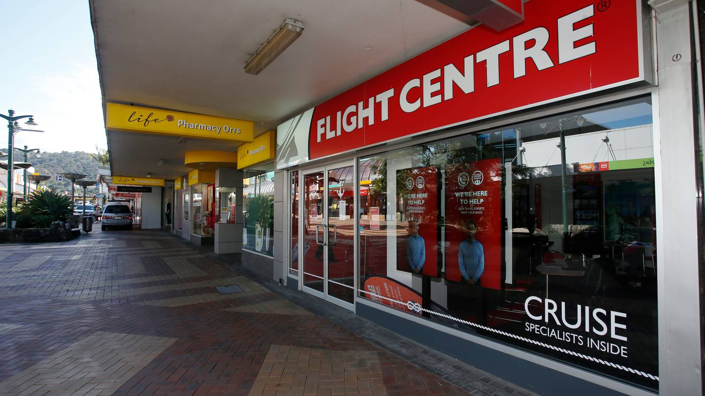 Flight Centre has closed more than half its stores around the country. Photo: Michael Cunningham ...