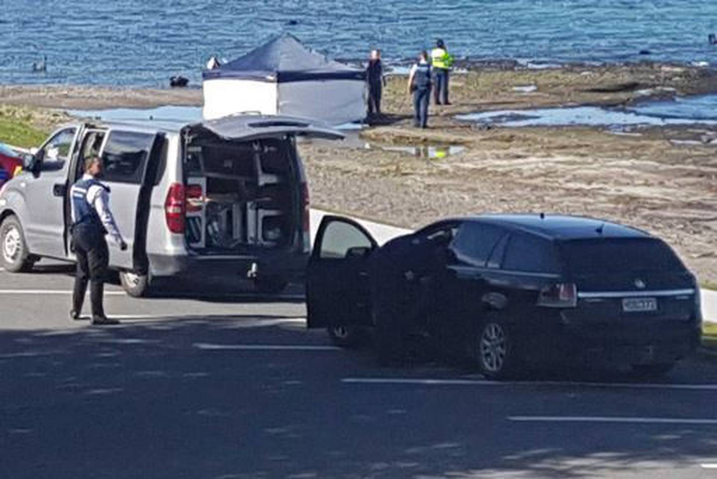 Police at the scene where the two bodies were discovered. Photo: Laurilee McMichael/NZ Herald