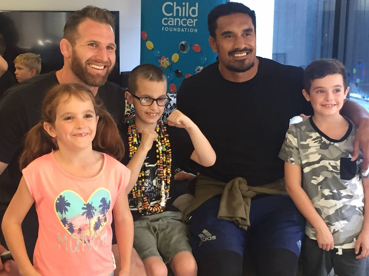 Caleb Wright, centre, pictured with former All Blacks Kieran Read and Jerome Kaino, and Brooke...