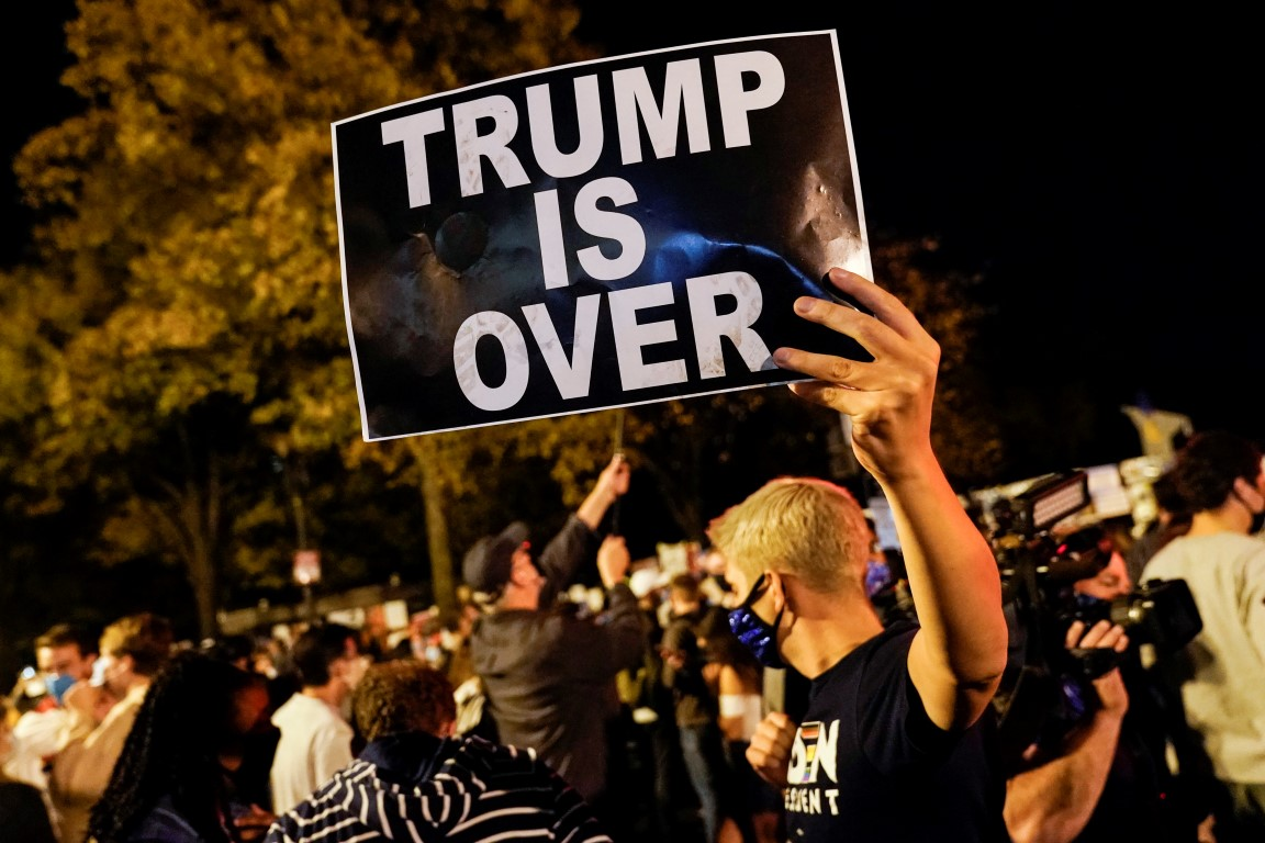 People celebrate at Black Lives Matter Plaza in Washington after media declared Joe Biden the...