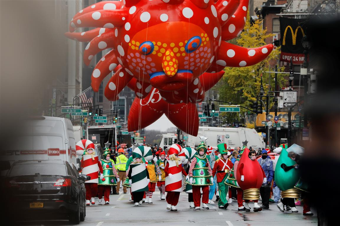 "Assistants carry Yayoi Kusama's ""Love Flies Up to the Sky"" balloon during the 94th Macy's..."