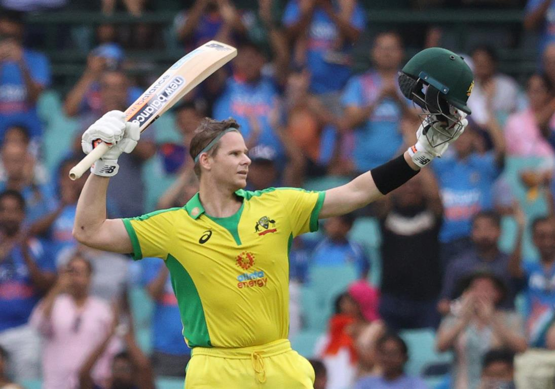 Australia's Steve Smith celebrates his century in the second ODI against India. Photo: Reuters