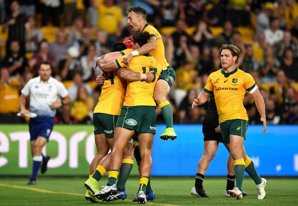 Wallabies players celebrate a Tom Wright try during the 2020 Tri-Nations match against the All...
