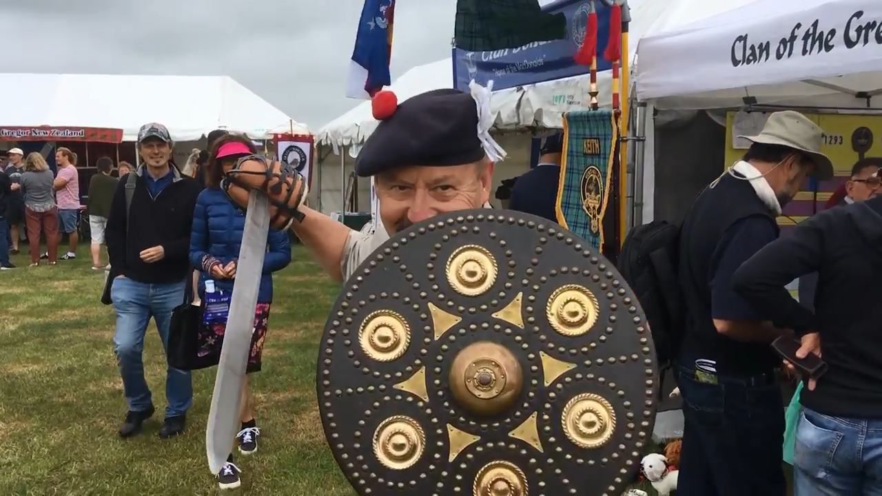 Clan Keith convener Ian Dickson demonstrates a couple of 18th century swords and a shield at the...