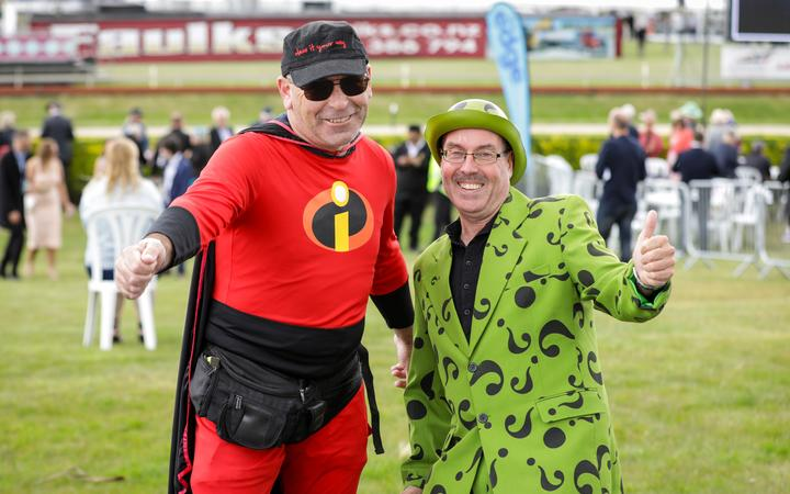 Mike Willetts, wearing a Mr Incredible costume and David Garters, dressed as The Riddler. Photo:...