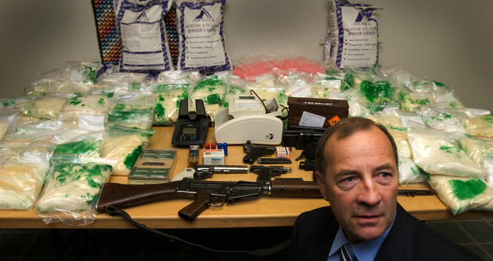 Detective Inspector Bruce Good with $95 million worth of methamphetamine which was intercepted as...