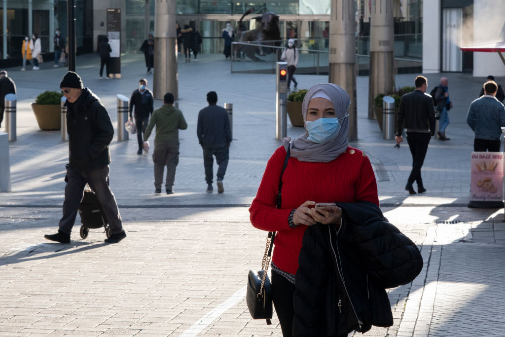People wearing face masks in the Bull Ring shopping area of Birmingham on the day it was...