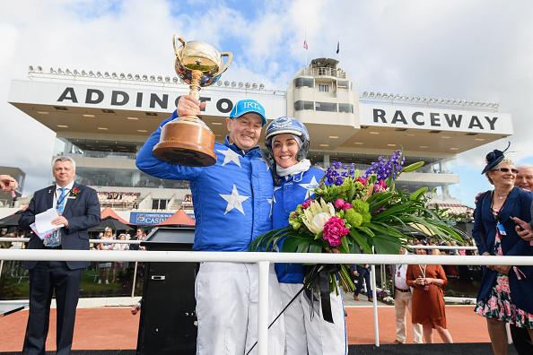 Mark Purdon driving Self Assured and trainer Natalie Rasmussen celebrate after winning Race 11...