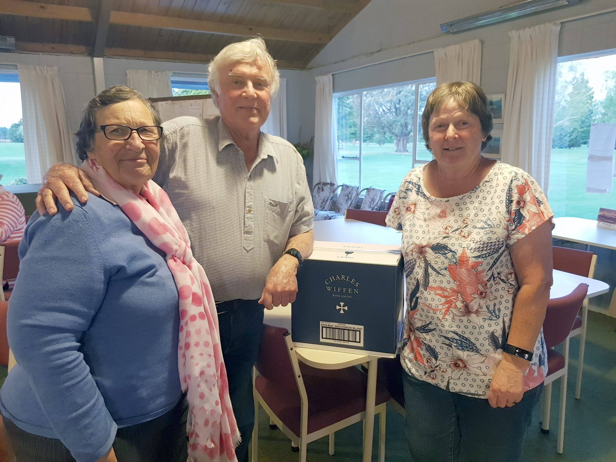Di Yates, left, with Sandy and Charles Wiffen, and one of the boxes of sauvignon blanc she...