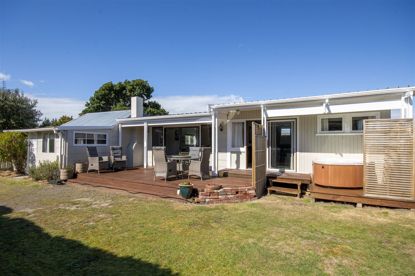 Harcourts real estate agent Lisa Tippen sold this bach at 23 Reserve Rd, Waikuku Beach, for $406...
