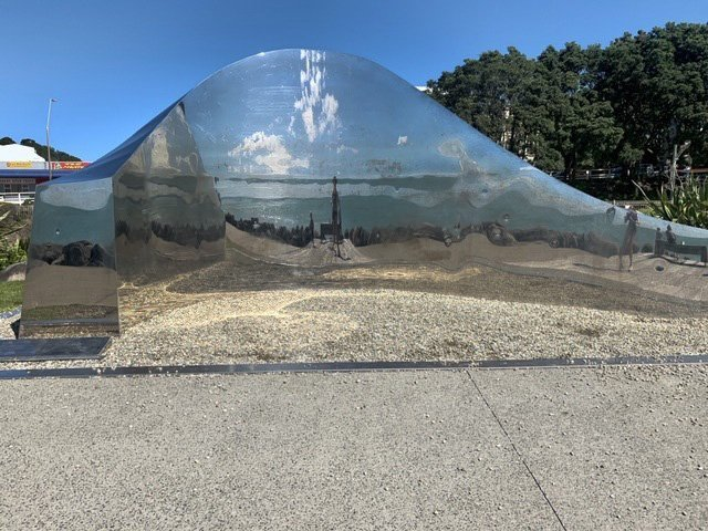 Light on the Land, by New Zealand artist Howard Tuffery, features a mirrored wave that reflects...