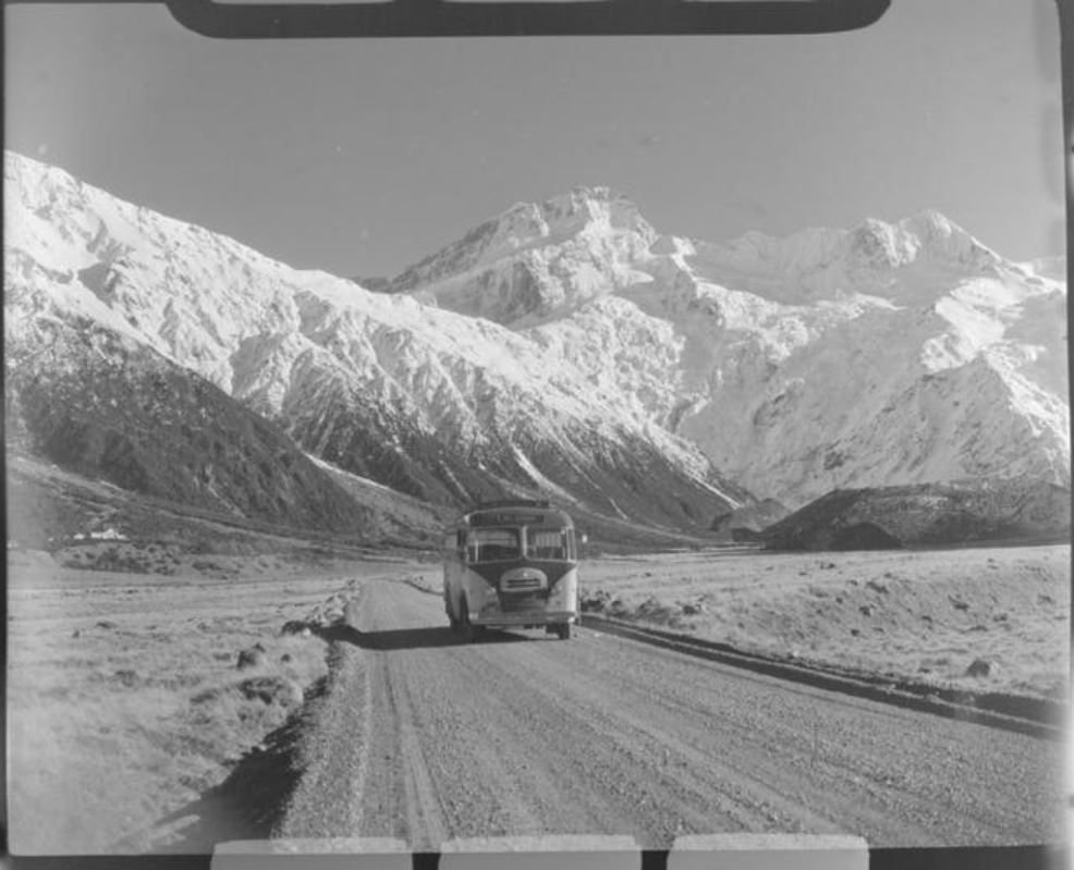 Mount Cook and Southern Lakes Tourist Coach on the Hermitage Road, Mount Cook Village, with Mount...