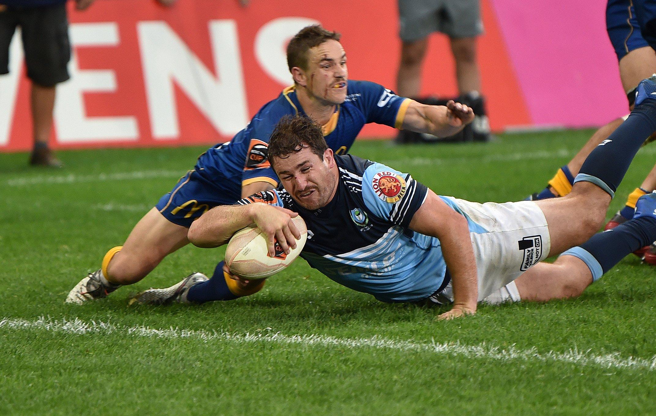Otago halfback Kane Hammington is too late to stop Northland captain Jordan Olsen from scoring...