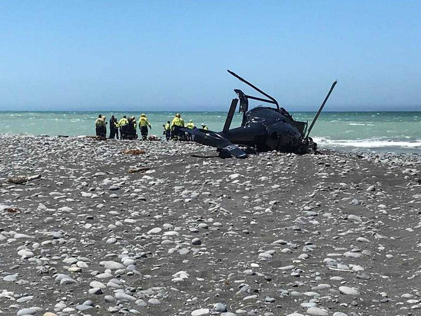 Two people were killed when the Airbus EC120 helicopter crashed onto the beach at Clarence, north...