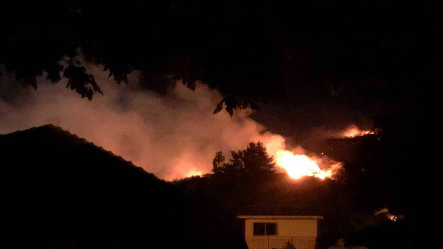 Flames could be seen through the night during a fire on the Port Hills on Friday. Photo: Hamish...