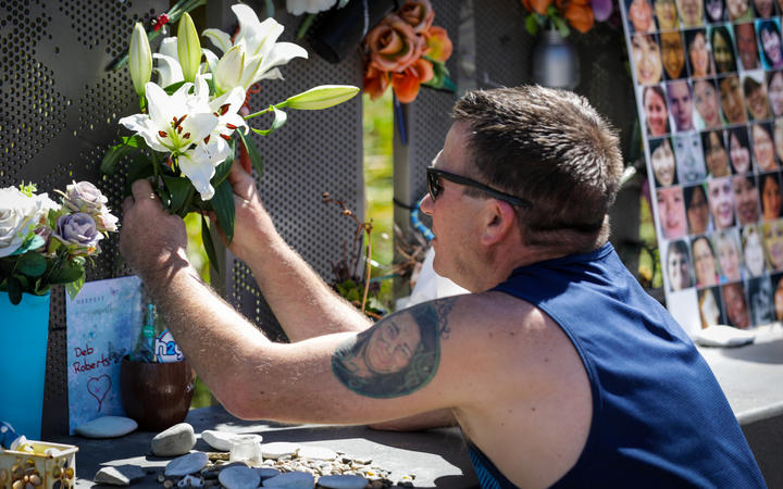 Tributes being laid to the victims of the CTV building collapse on 16 December, 2020. Photo: RNZ ...