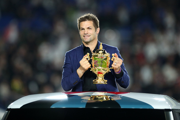 Richie McCaw with the Webb Ellis Trophy during the 2019 Rugby World Cup final between England and...