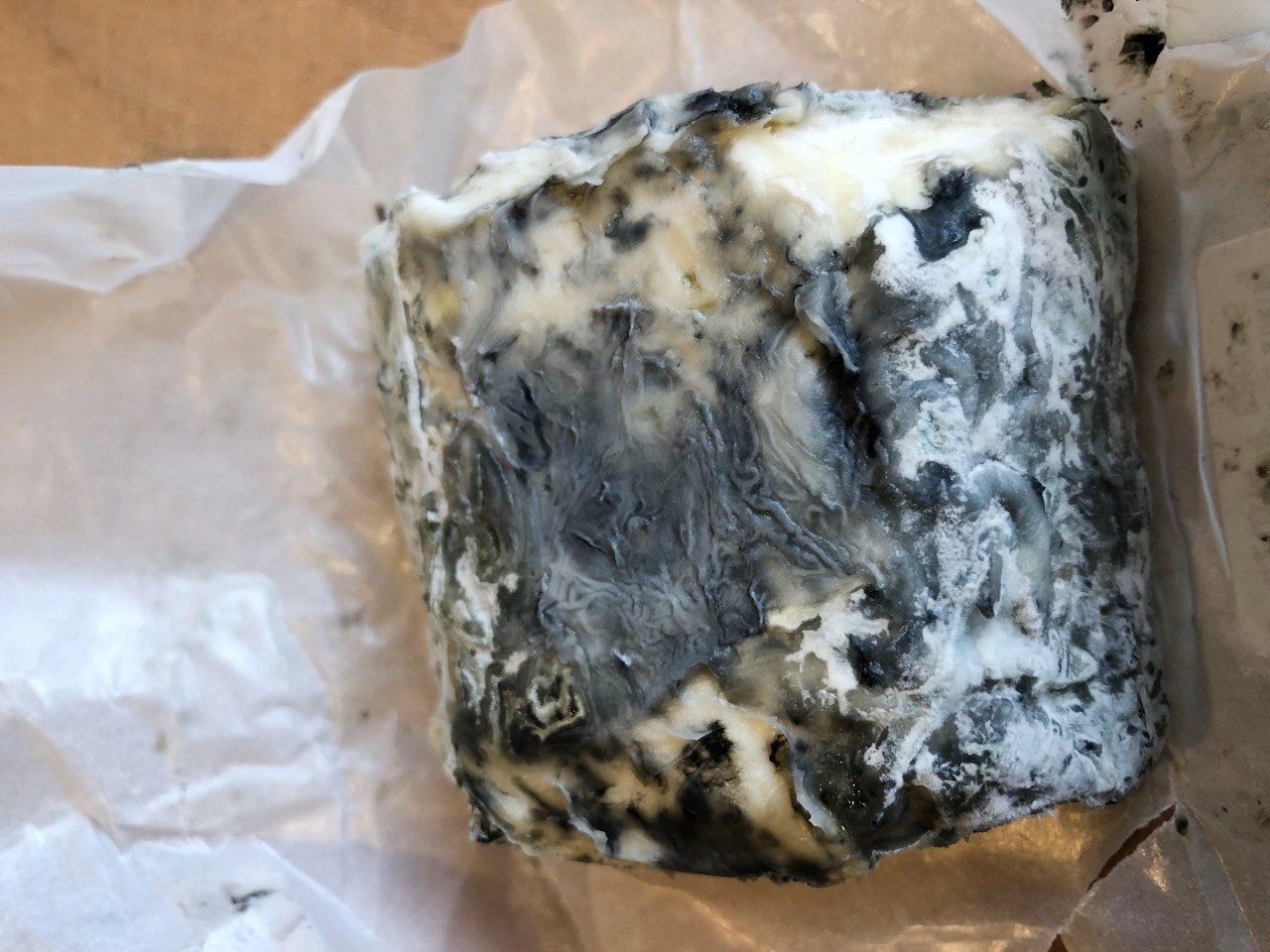 Grey furry mould on an artisan ash-coated goat's cheese is  ugly but not harmful and, according...