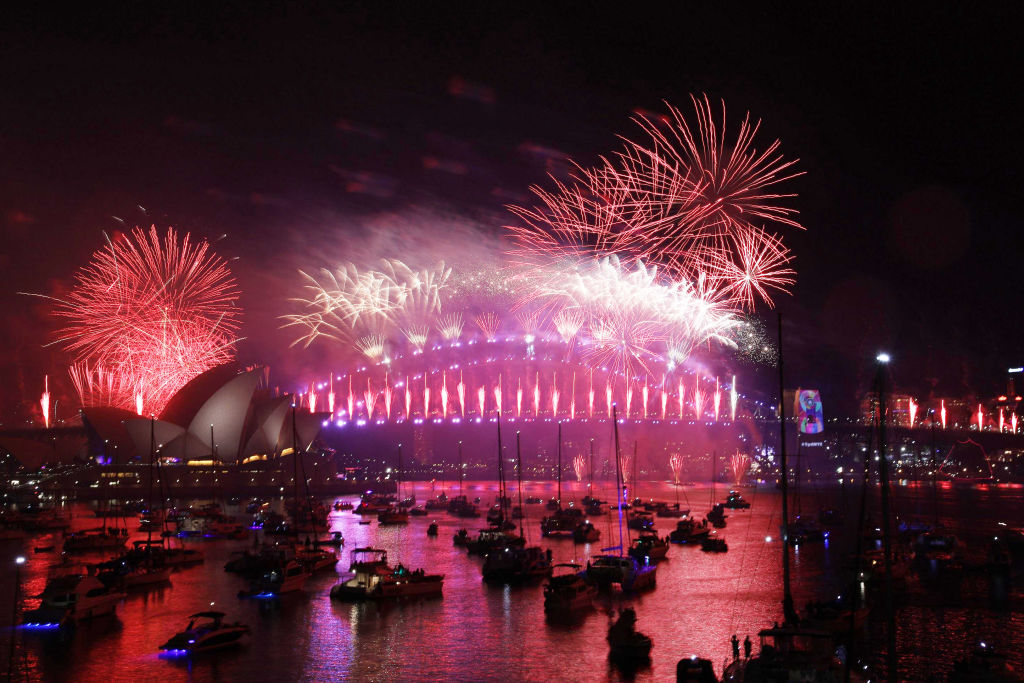 Fireworks explode over the Sydney Harbour Bridge during the New Year's celebrations. Photo: Getty...