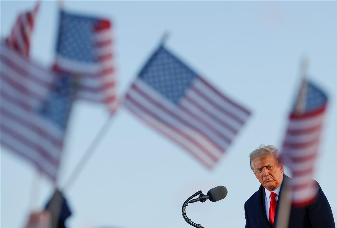 US President Donald Trump speaks at Joint Base Andrews in Maryland after leaving the White House....