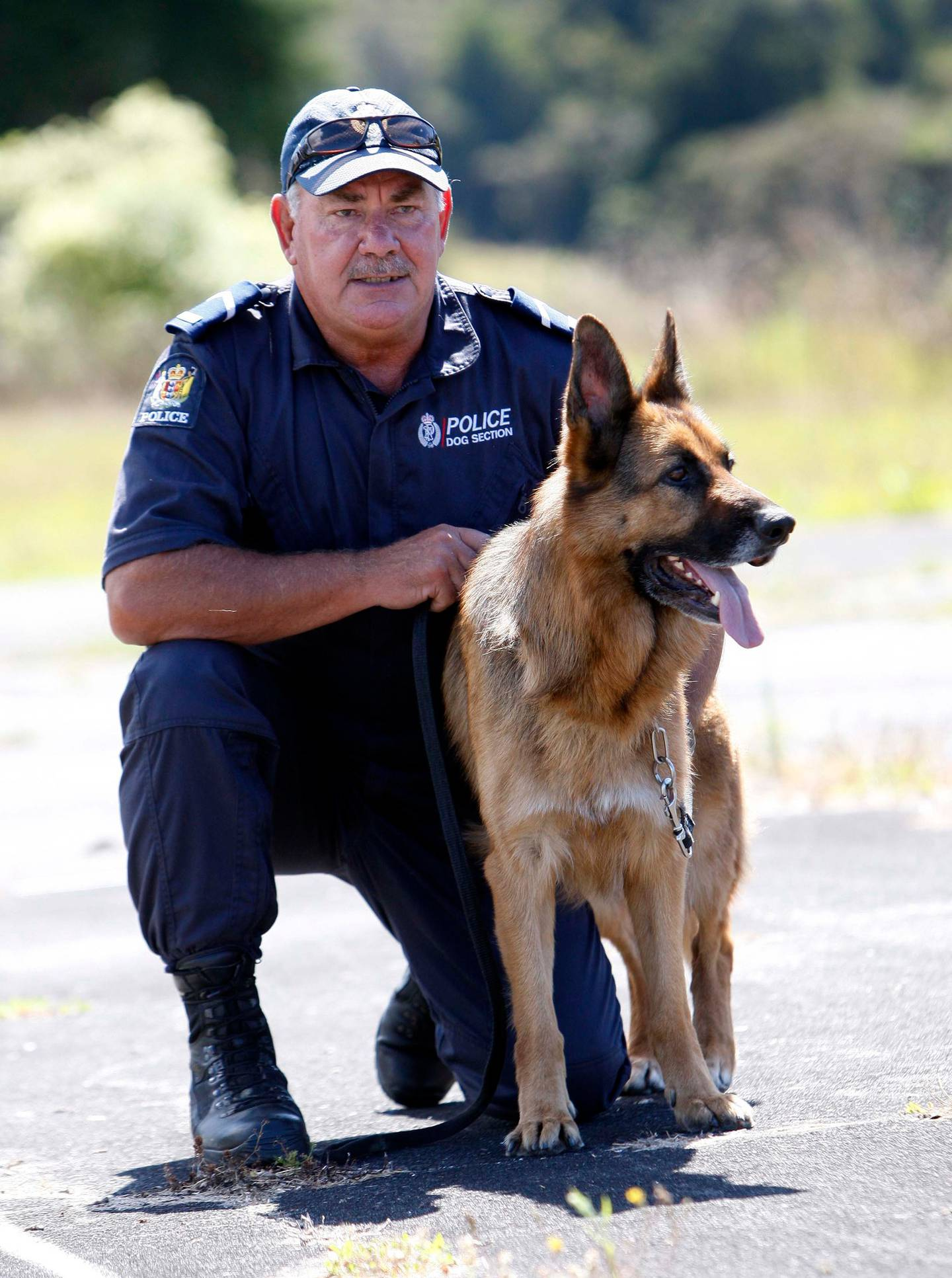 Senior Constable Ross Clarke and detector dog Archie in 2013. Photo: Michael Cunningham