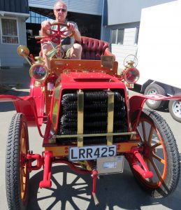 Gavin Hunt behind the wheel of the impressive 1903 Darracq at his workshop. Photo: Supplied