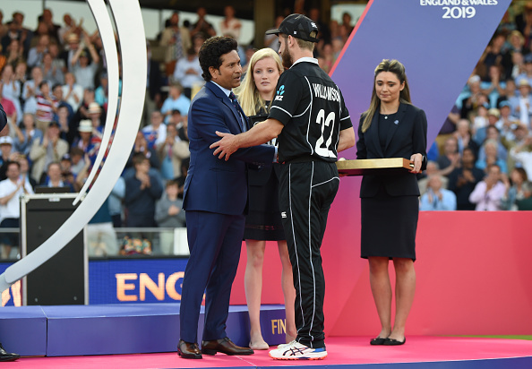 Kane Williamson is presented with his man of the tournament award by Sachin Tendulkar after the...