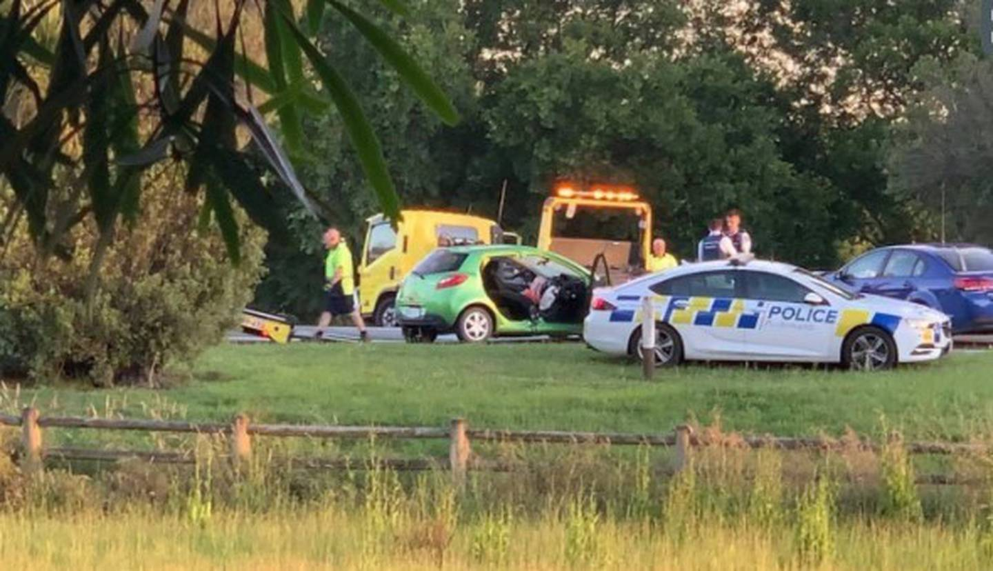 A wrecked car surrounded by emergency vehicles after a dramatic police incident in Feilding...