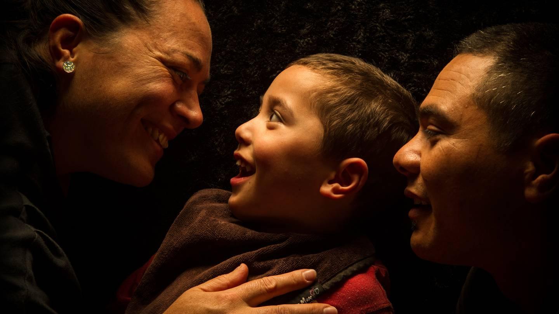 Marama Renata (left) and husband Wi Renata with their son Neihana who was severely brain damaged...