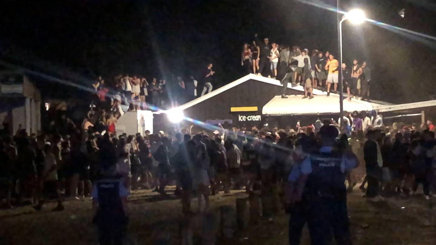 Teens on the roof of Blackies Cafe in Whangamata overnight. Photo: Jane Phare via NZ Herald