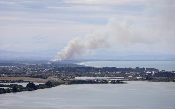 A fire at Pines Beach, near Kaiapoi north of Christchurch, on Monday. Photo: RNZ