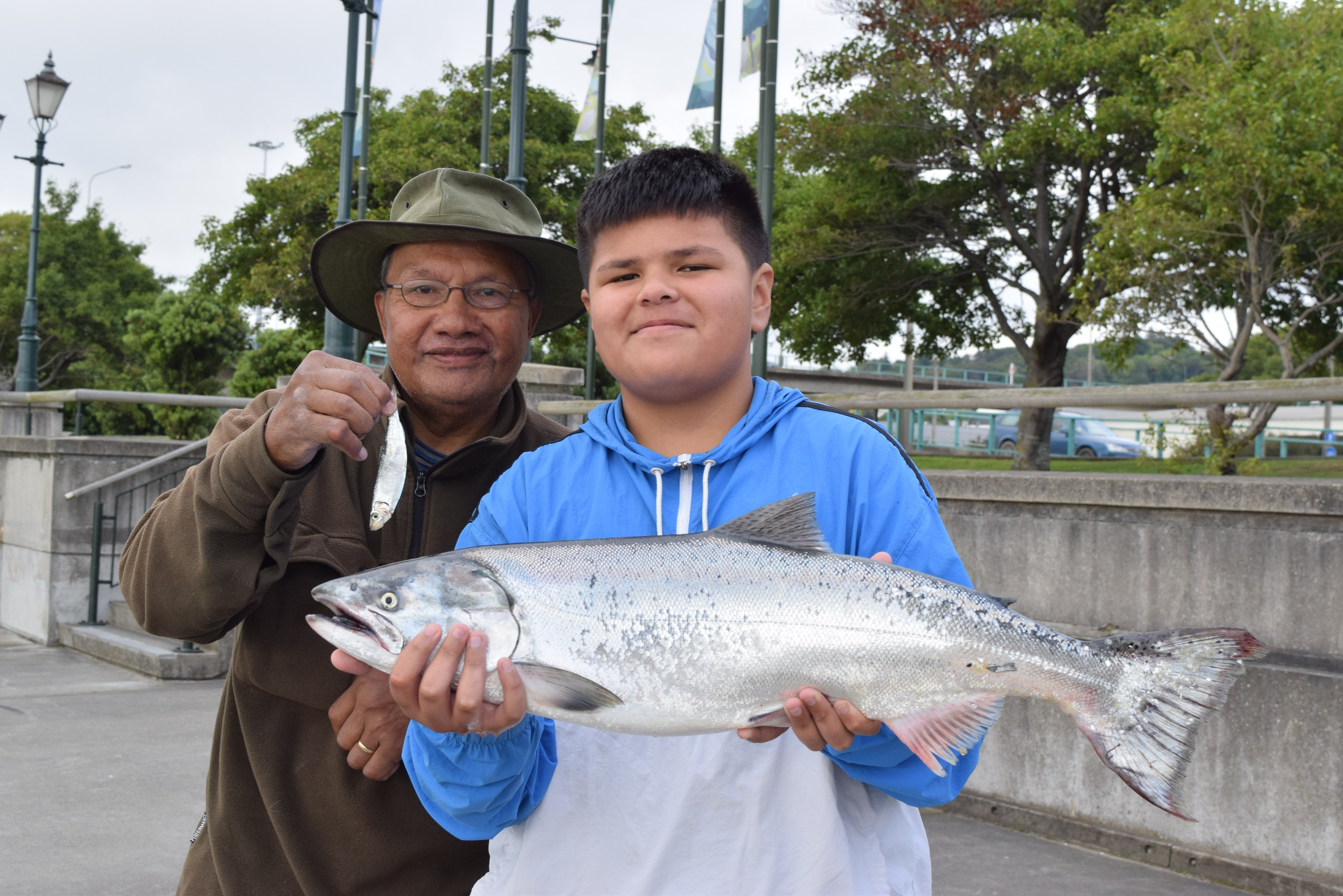 Montell Paulo (12) displays a salmon he caught at Steamer Basin while fishing with his...