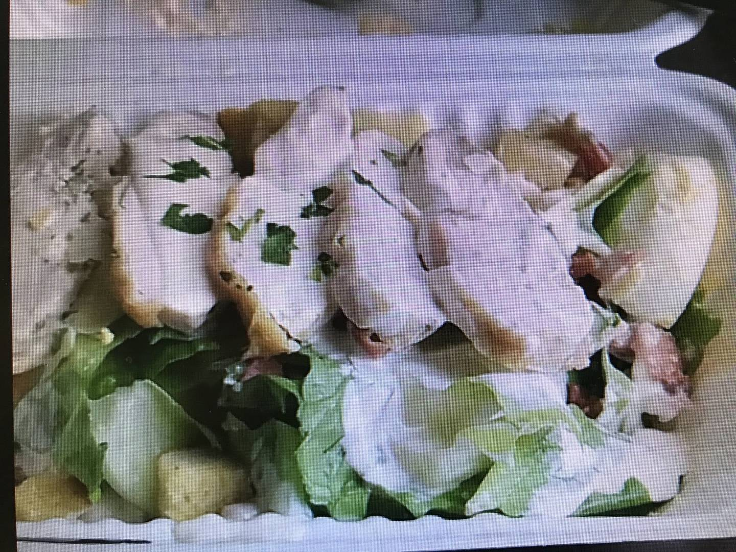 The man's lunch in MIQ at the Crowne Plaza Hotel was a ceaser salad and croutons which the man...