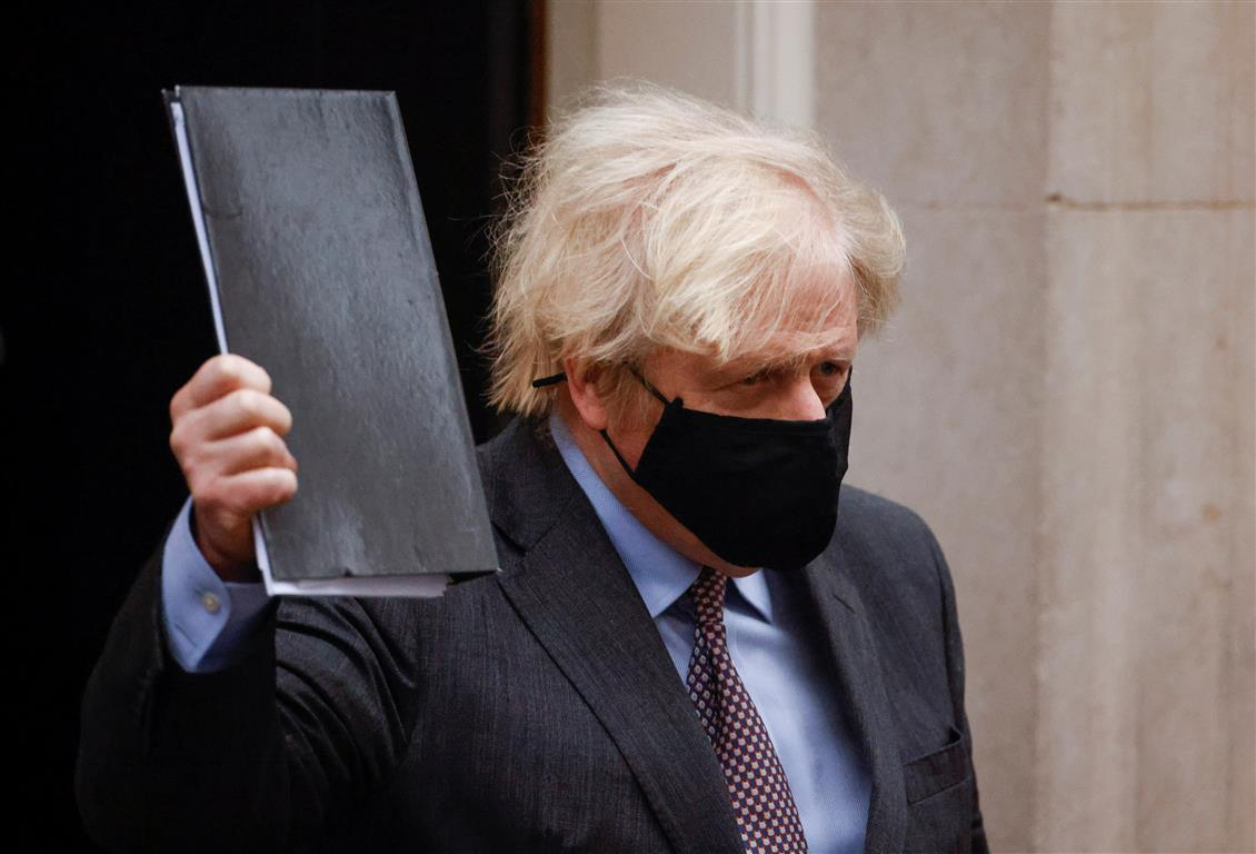 Boris Johnson leaves Downing Street in London. Photo: Reuters