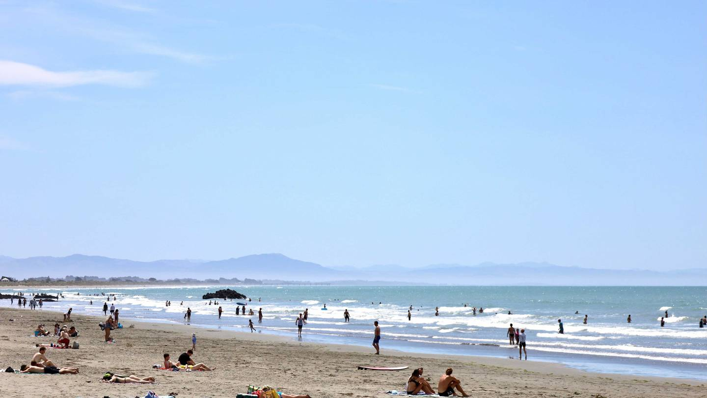 People enjoying the hot weather on Sumner Beach, Christchurch. Photo: George Heard / NZH
