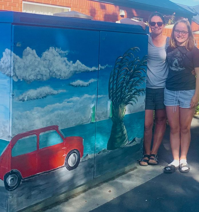 Anna Jemmett and daughter Freya with the red mini artwork. Photo: Supplied