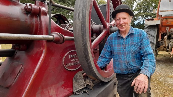 Peter Lynn shines up his stationary Tangye 1902 oil engine ready for the auction. Photo Toni...