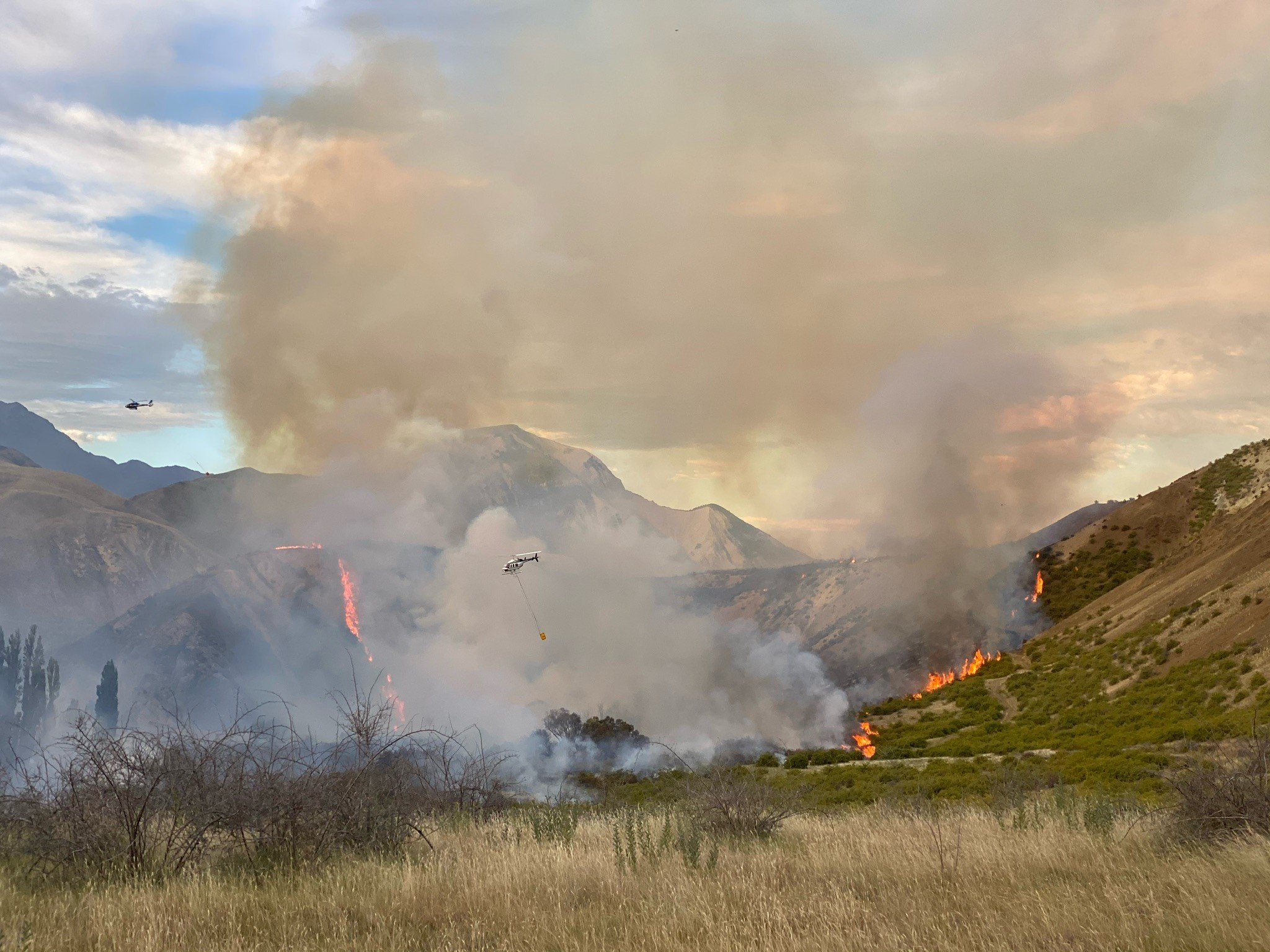 Helicopters working at the scene of the Clarence Valley fire. Photo: Fire and Emergency NZ