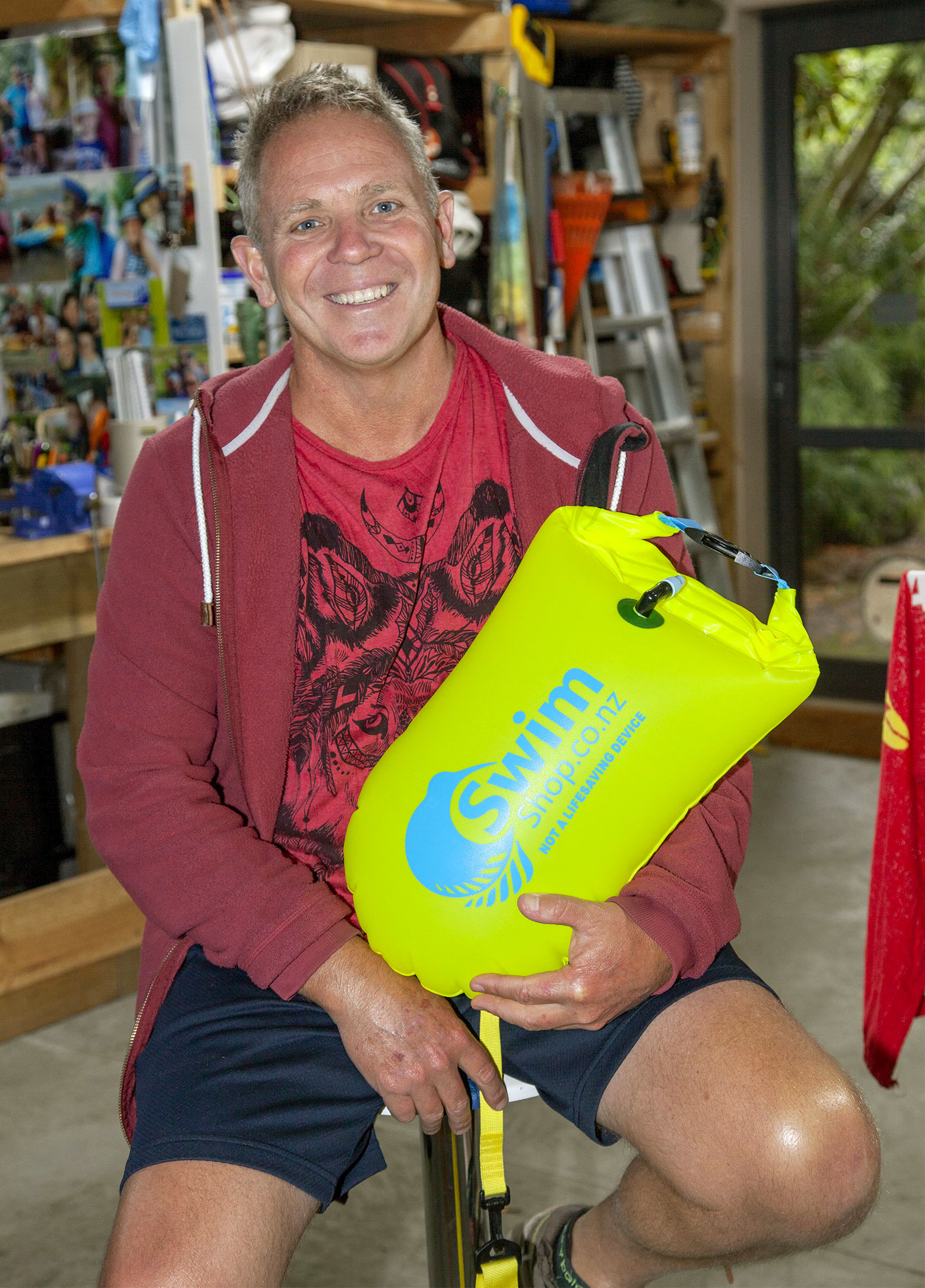 Mark Bone with an inflatable tow float used by competitors in the swim.  Photo: Geoff Sloan